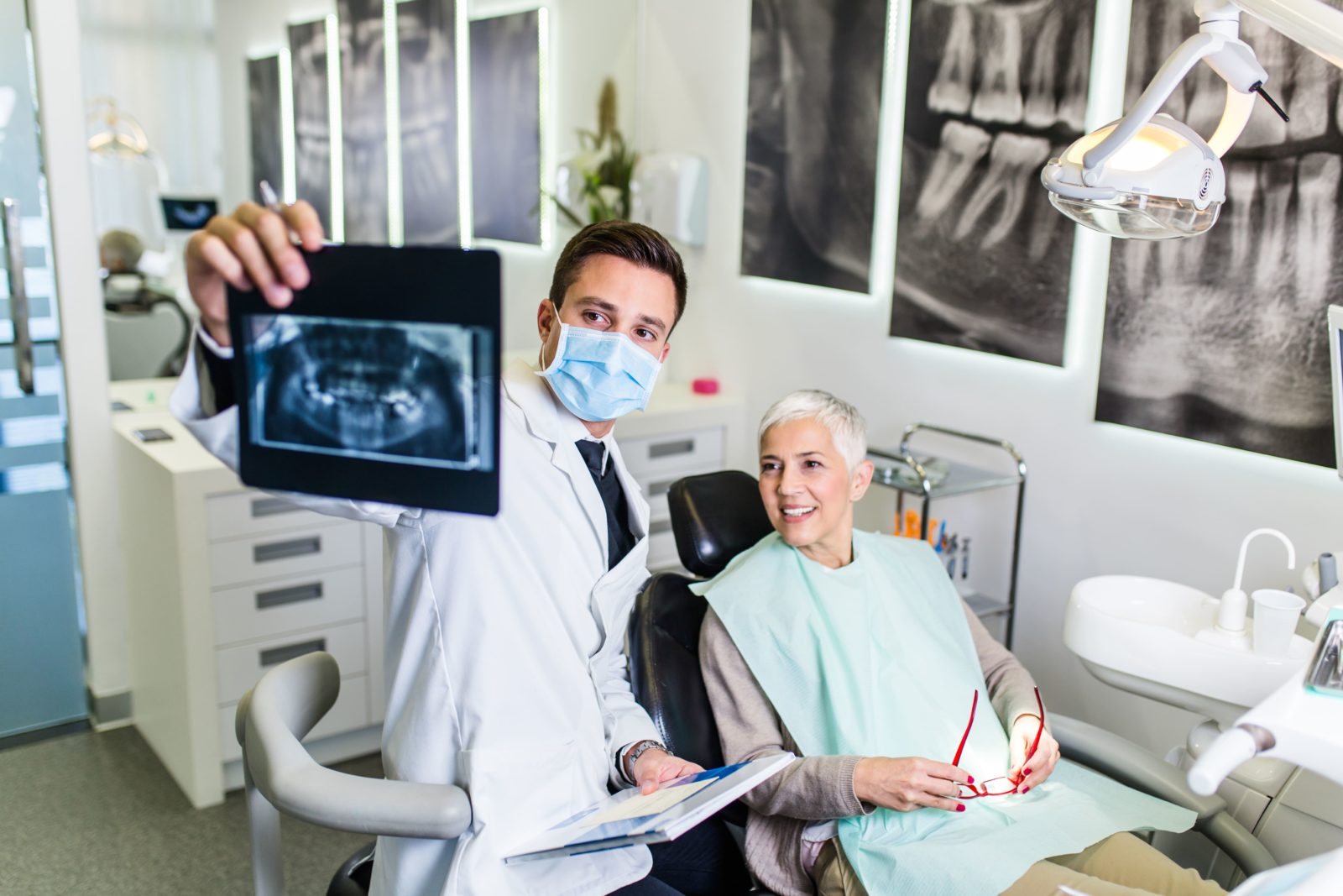 dentist review dental x-rays with patient